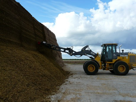 using a silage defacer  on a silage bunker